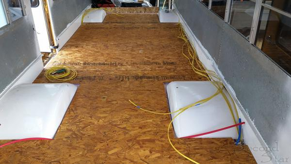 Subfloor with plumbing and wiring
