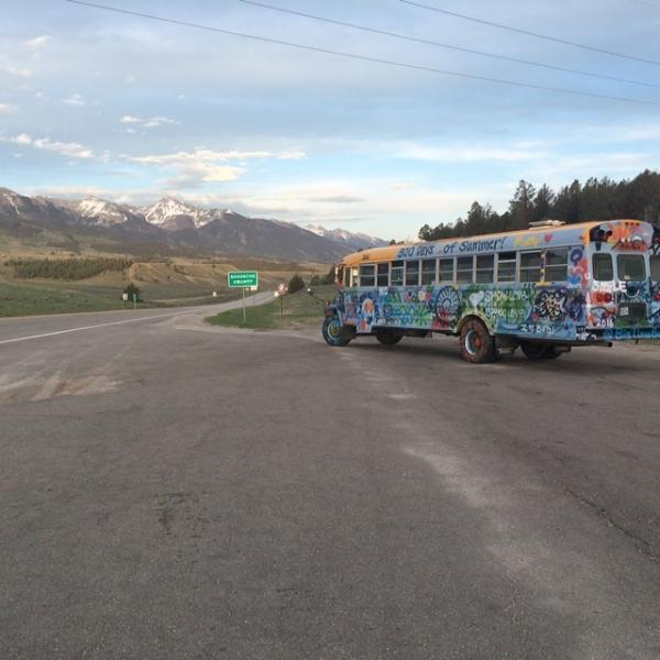 Taking a break at a beautiful Colorado mountain pass.  Bus is a workhorse. Driver, not-so-much.
