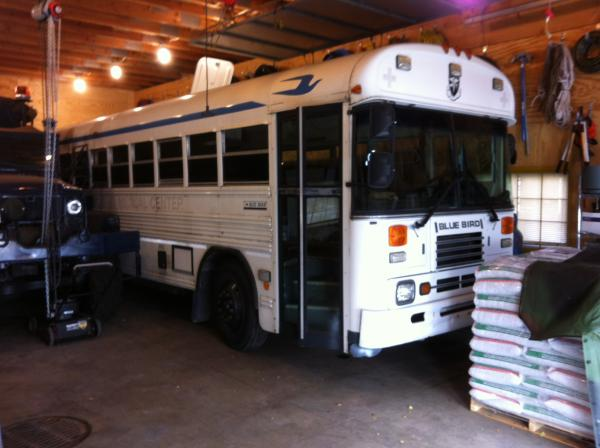 Bus parked in garage early in conversion process