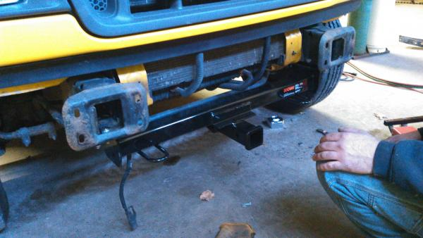 Front bumper off to paint, installed new Curt front mount hitch receiver.