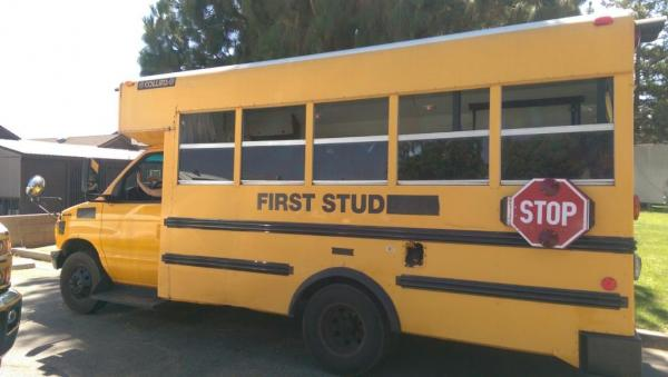 After we bought the bus, we had to remove the words school, student and stop when flashing to drive legally home