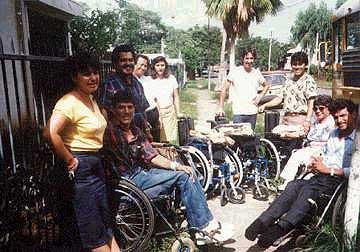Patrick with donated wheelchairs Central America 1992