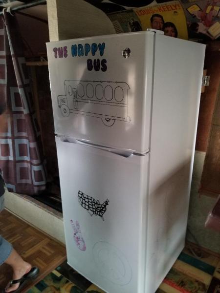The fridge. Original owner started painting. I will finish.