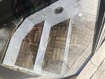 Flex seal rubberized... (didn't work great)  Teak outdoor patio tiles( good idea, needs more work)