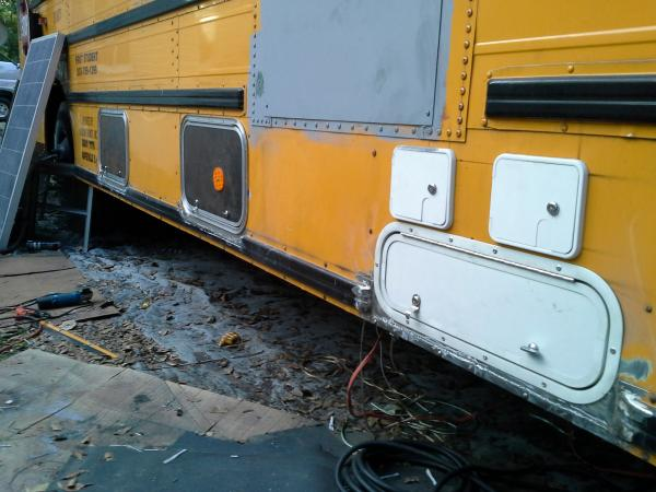 Under bus storage doors