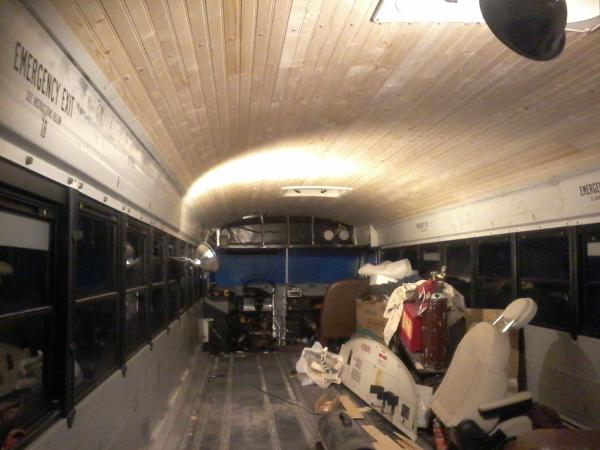 Ceiling is done and both metal strips above the windows are back in place.