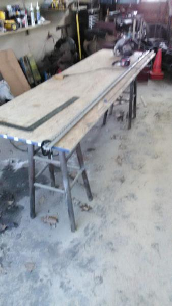 """I used one of the 100"""" chair rails I removed from the floor (and 2 clamps) as a fence for cutting the furring strips.  Yeah, I know the picture is fuzzy, sorry 'bout that.  Worked pretty well when you don't have a table saw at your disposal."""