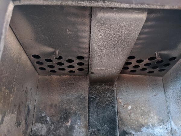 Inside top of the Cubic Mini wood stove.
