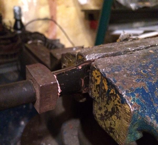 Forming the copper into battery cable lugs.