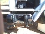 Step tank on truck