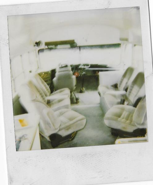 9 59 38 scan95851120 poor quality picture. Front seating area. All seats from a passenger van.