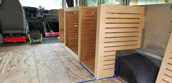 Cabinets going up. These were made from upcycled bakery shelves from the Trader Joes I work at.