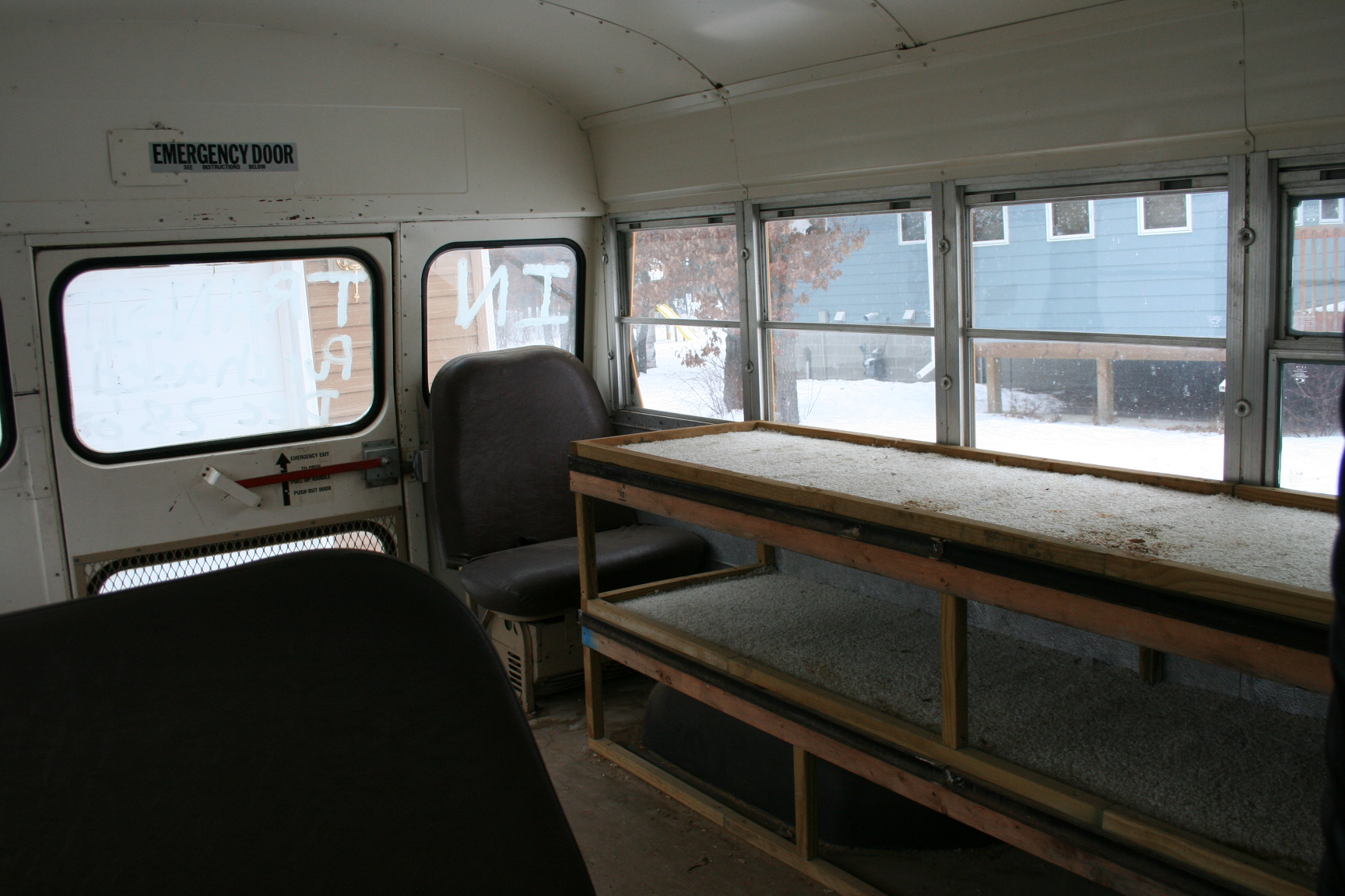 rear area of bus and bench