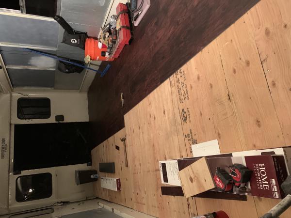 Waterproof vinyl click and lock flooring being installed