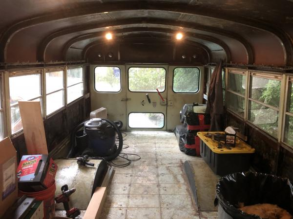 Seats, flooring, wall panels and ceiling panels, plus insulation are out! Now onto rust mitigation.