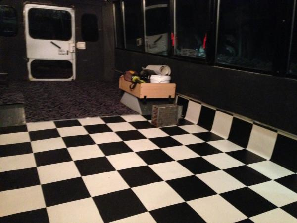 The rear part is carpeted, and will have the beds for the kids. The checkered is the retro kitchen flooring.