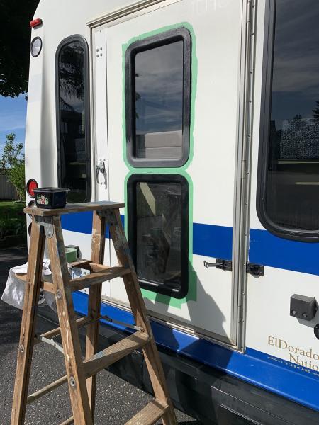 Painting the faded black trim around the windows