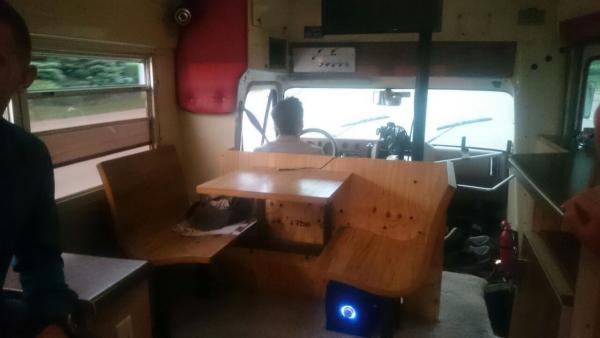 Wooden booth from a Mcdonalds from the 60's. Sound system with bass under seat. Tv hanging from the ceiling!