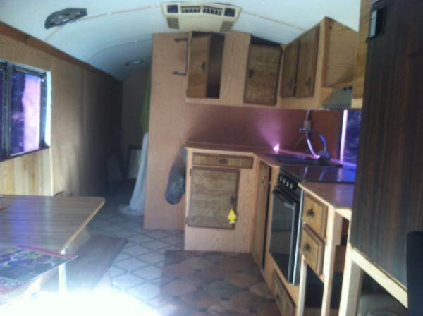 Inside of the Gillig when purchased. Previous owner had two bedrooms and a bathroom