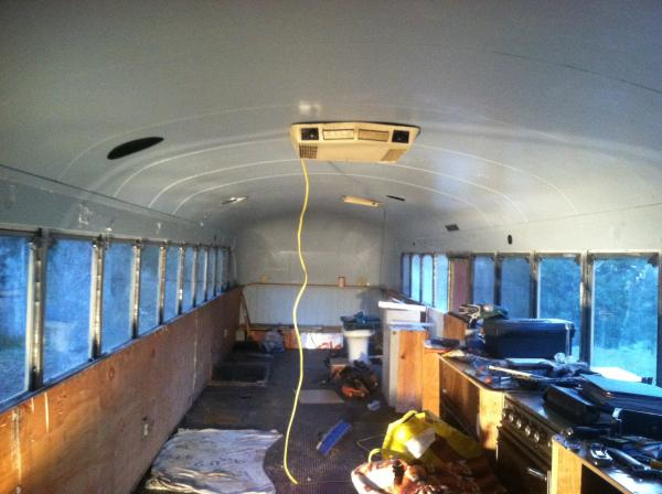 Day 2 of demolition: Opened up windows, ceilings, and exposed original rubber flooring to give an extra 1.5 inches of headroom