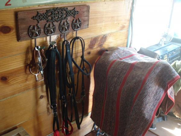 Right behind the driver's seat is my saddle and tack, mounted to the wall.