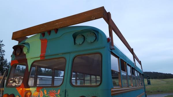 4th, mounted the 2x8 perimeter also pressure treated, screwed together using adequate of screws. as you can see the back piece fits over the lights and extends just past the end of the bus to avoid having to notch around the curve of the roof.