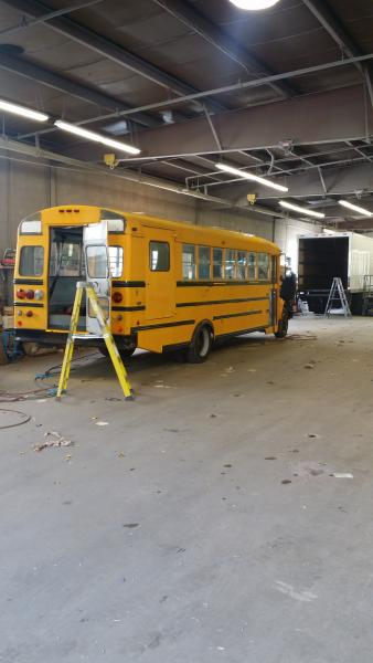 View of the bus being prepped for painting.