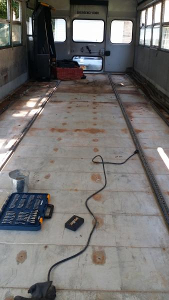 Pulled the floor up.  The tracks are very challenging but they have to come up.