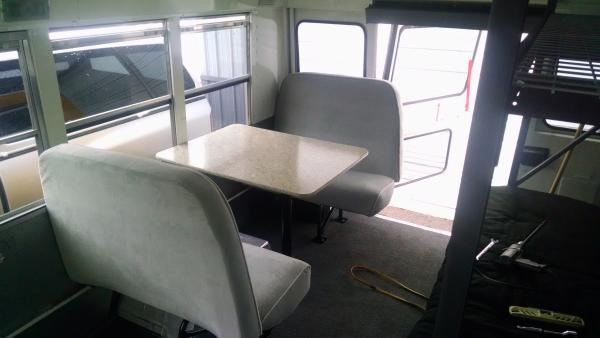 Dinette using re-upholstered/recushioned bus seats.