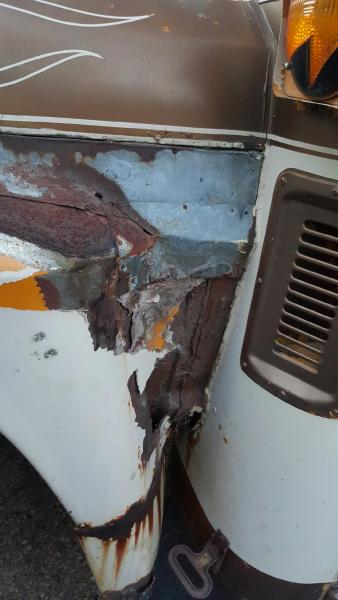 Driver side fender - they had put bondo over galvanized metal over fiberglass....