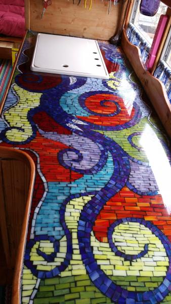 the Kitchen counter top with custom mosaic tile and polyurethane protective coating....