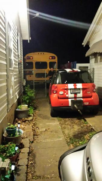 The bus barely fit in our drive (should have measured first)but she made it home and into the driveway...Also shown is my little smart car that we plan on towing on our Adventure before Dementia...