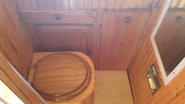 Our compost toilet, recessed toilet paper holder and stained wood...