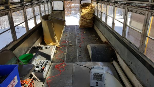 After everything was removed.  Insulation stacked, panels saved, everything before cleaning the bus and organizing the trash material.