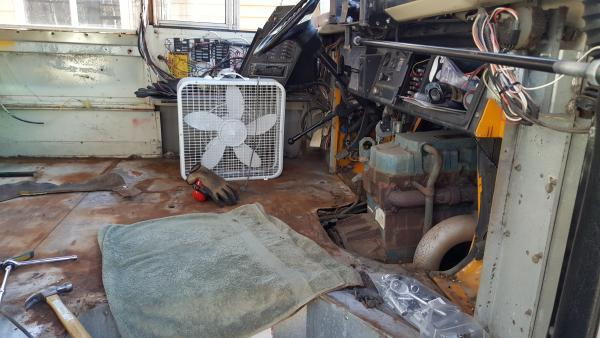 Side view of driver floor panel rust and engine hump removal.  The engine cover was massive compared to the engine.