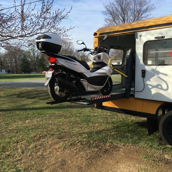 This picture show the PCX150 being loaded into the bus. The idea is to wall off the back 5 feet as use it as a garage and storage.